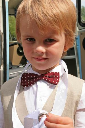 Page boy at a vintage wedding as featured on The National Vintage Wedding Fair blog