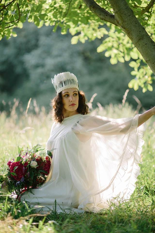 1970s vintage wedding boho bride with feather crown photo by Binky Nixon for the National Vintage Wedding Fair
