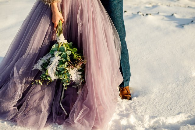 Elopement Winter Wedding in Iceland with Coloured Bridal Gowns and Regal Headresses