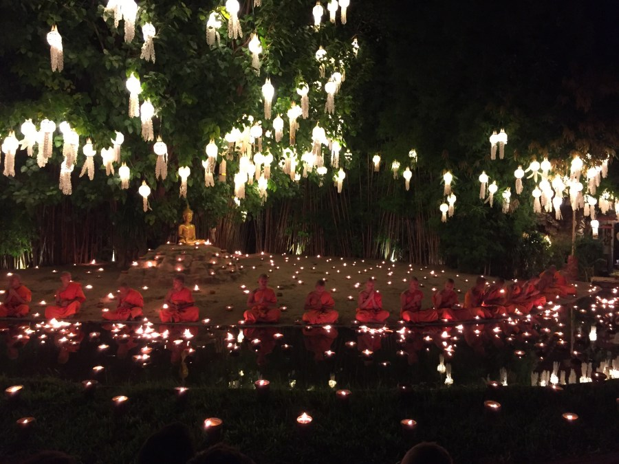 Monks lead a chant at the Wat Phan Tao Temple in Chiang Mai, Thailand to kick off the Loy Krathong and Yi Peng festivals.
