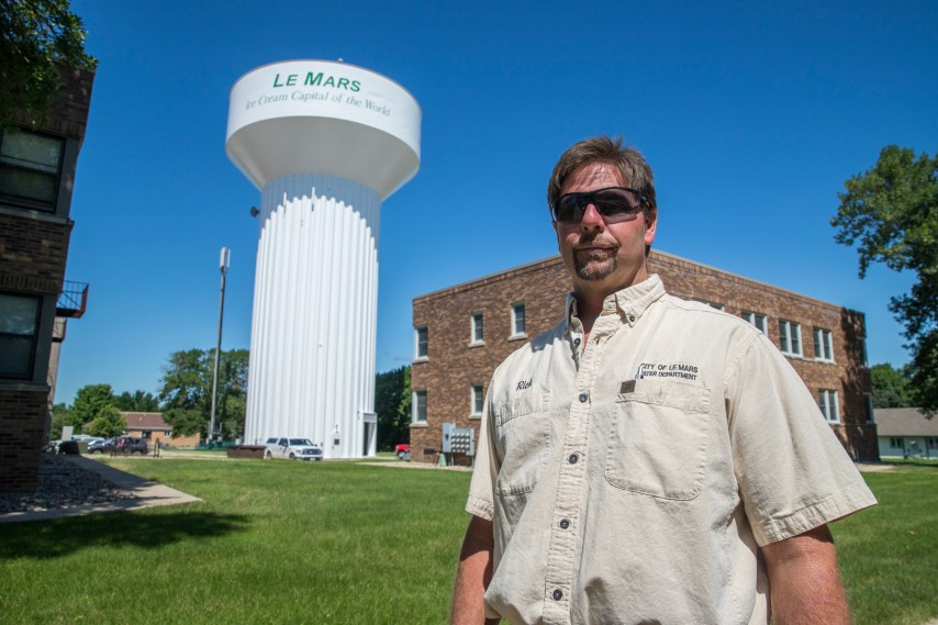 Water Superintendent Rich Sudtelgte in front of water tower
