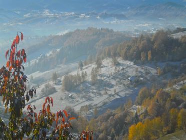 The morning after snow; blazing sun melts the winter and autumn colours return in Magura and Pestera, Romania