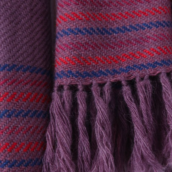 This scarf has been woven on a handloom and dyed using natural plant dyes, shellac, indigo and madder giving it its rich colours of purple, red and blue presented separately in a twill weaving techniqueEthically made in india and certified by Craftmark as hand woven and hand-dyed.Made with a blend of super fine wool & merino wool yarns.