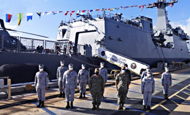 Members of the Naval Task Group 80.5 pose for a photo opportunity at the closing ceremony of the 'Rim of the Pacific' at the Pearl Harbor in Hawaii, 1 September 2020.