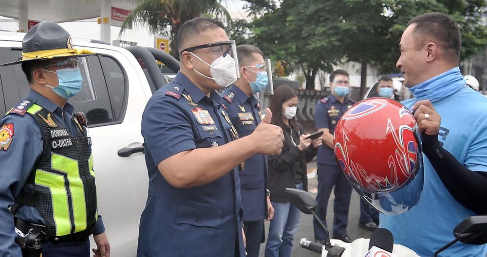 New HPG Director-General Tagum inspects buses in QC, hands out free helmets to passing riders