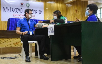 Manila holds mock Covid-19 vaccination