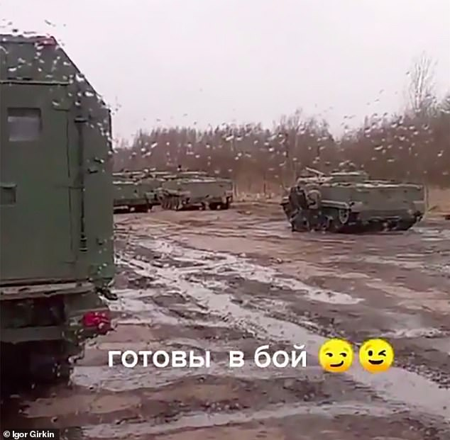 'Ready for conflict': Putin's threat to the West is laid bare in new footage showing build-up of troops and military convoys on Ukraine's border