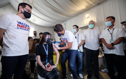 Manila gifts OFWs, other essential workers with free jabs