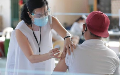 QC villages assist in booking vaccination appointments