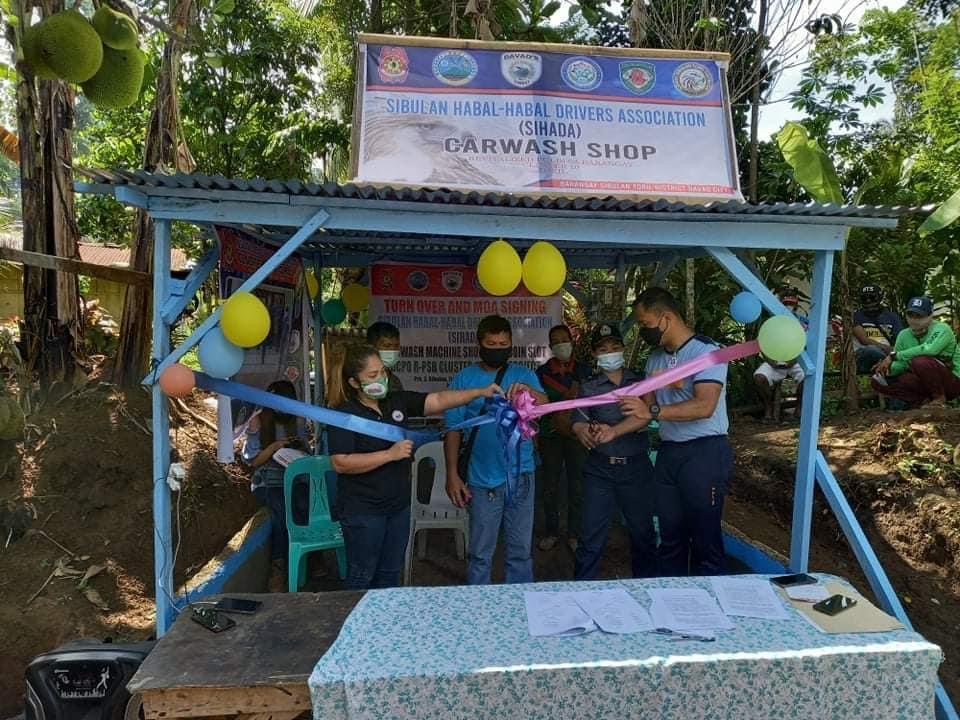 Davao City cops provide carwash services to the community
