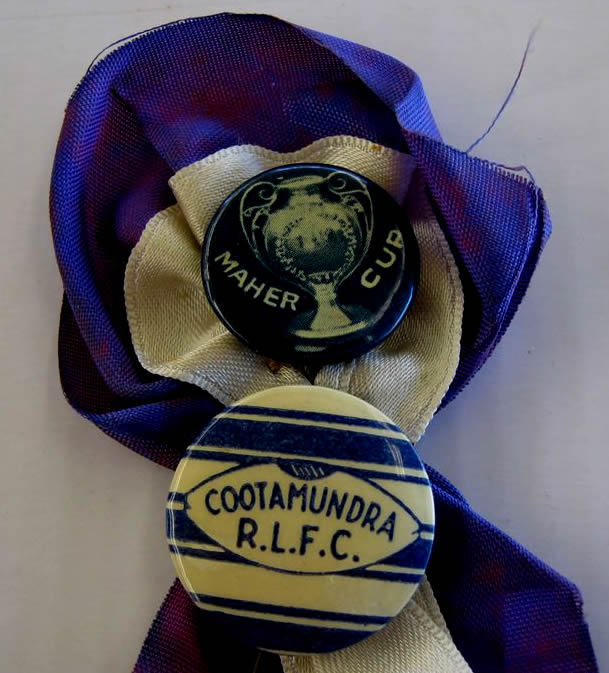 Rosette featuring Maher Cup and Cootamundra badges. Made by Maude Powell in about 1946. Thanks to Peter Simpfendorfer.