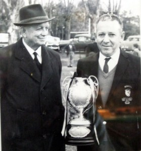 Vic Castrissian holding the Maher Cup, with local member Billy Sheahan at Gundagai