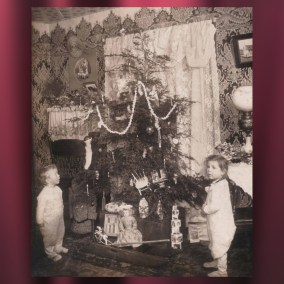 Christmas tree decorating has long included a combination of homemade and store-bought ornaments and trims. This tree, trimmed by the Megown family, features toys and gifts nestled into the tree boughs, candles, popcorn strings, treats, and store-bought paper and glass ornaments. Dorothy and Harold Megown are pictured in front of the tree, circa 1907. Original photo by John D. Megown.  <br><br>Gift of Tom Molocea, 2007.78