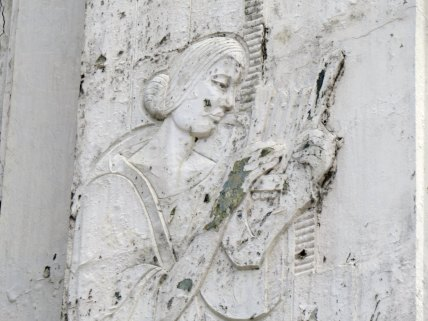 One of the relief designs on the building, a woman holding a lyre