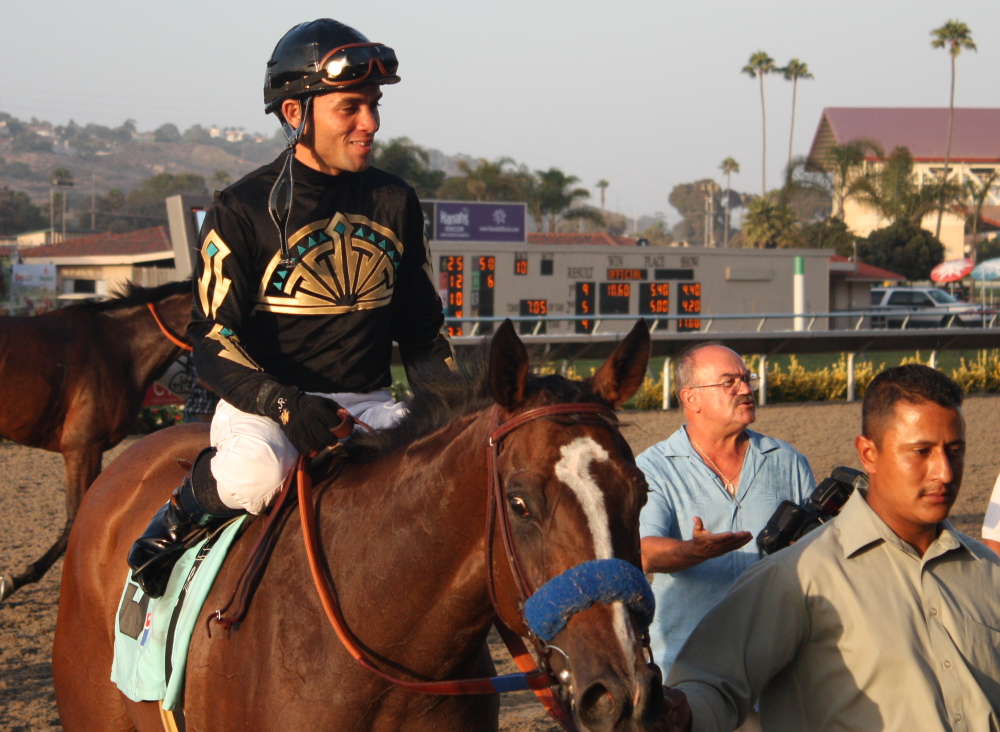 Joel Rosario can't hold his smile back after he won the nightcap on Saintly Spirit