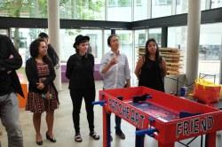 "Jessica, Betari, and Estefania explaining their ""Ice Cream Machine for the Heartbroken"" machine."