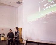"""Anna Clark and Hector Daniel Vargas presenting their project """"Permacyclopedia,"""" an app that provides data about plant life"""
