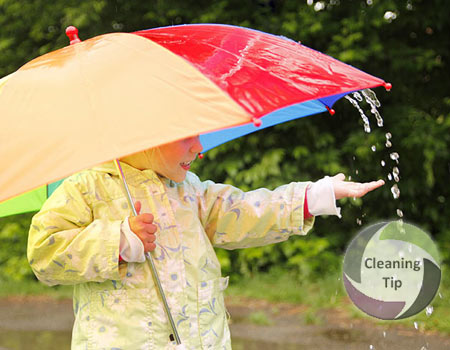 How to Clean an Umbrella. kid under a clean umbrella