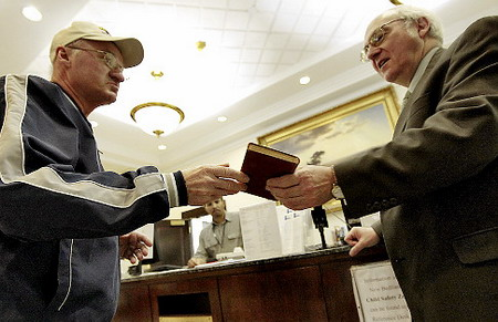 Stanley Dudek returns book overdue by 99 years to New Bedford Public Library in Massachusetts
