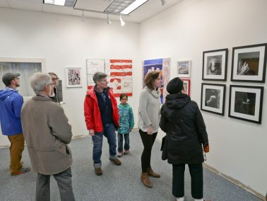 Opening crowd at UMVA April rachel macdonald curator in white sweater light in the dark openingwade photoSMshow 1 of 1 copy
