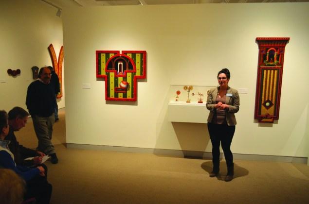 "Michael Grillo (left), a UMaine art professor, alongside Kat Johnson (right), an education director for UMMA, discuss Richard Whitten's exhibit, ""Studiolo"" at the University of Maine Museum of Art in Bangor on January 30, 2016."