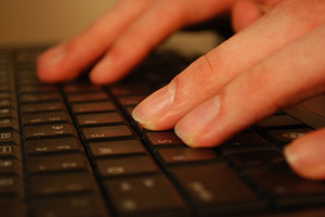fingers on computer keyboard