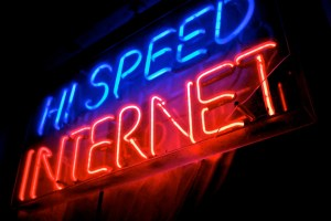 Neon sign with the words Hi Speed Internet