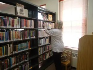 volunteering at Treat Library, Livermore Falls, in 2012