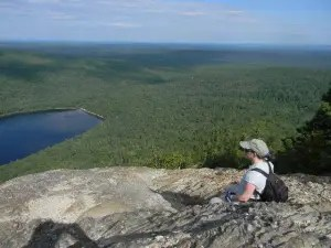 My sister Liz looks out over South Branch Pond from North Traveler Mountain in the northern park of Baxter State Park.