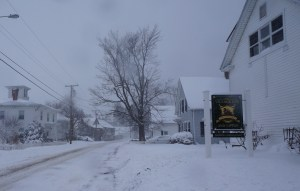 A snow-covered street in a small town