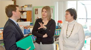Main page image. Commissioner Bowen stands in a classroom with two teachers.