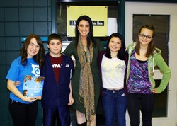 A guest author poses with Bonny Eagle Middle School students.