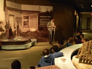 Joanna Torow, Maine State Museum's chief educator, provides information to students from Rangeley Lakes Middle School.