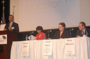 Commissioner Stephen Bowen reads questions from the audience to the first panel of presenters at the Governor's Conference on Education.
