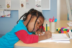 East End Community School kindergartner Christine Akilimali practices math word problems.