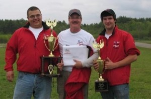 Students pose with their instructor, holding their first-place trophies for Maine's Ford/AAA Student Auto Skills Competition.