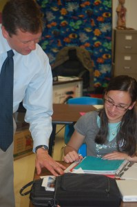 Mountain Valley Middle School student Abby LaBrash explains her genetics project to Commissioner Bowen.
