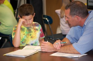 Fifth grade teacher Mike Louder provides one-on-one reading instruction to Austin Taylor at Canaan Elementary.