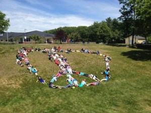 Coastal Ridge Elementary students form a peace sign