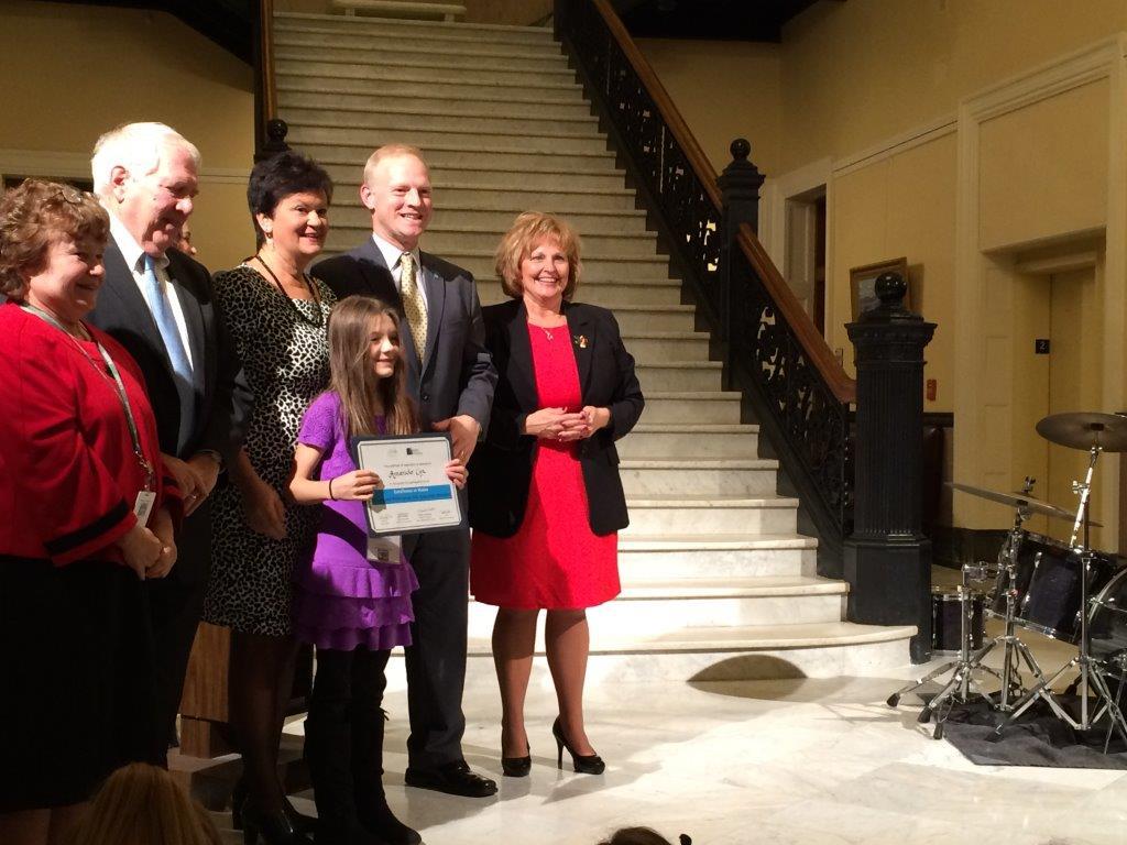 Third grader Amanda Cox poses with certificate