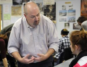 Shane-Gower sharing ideas with a student