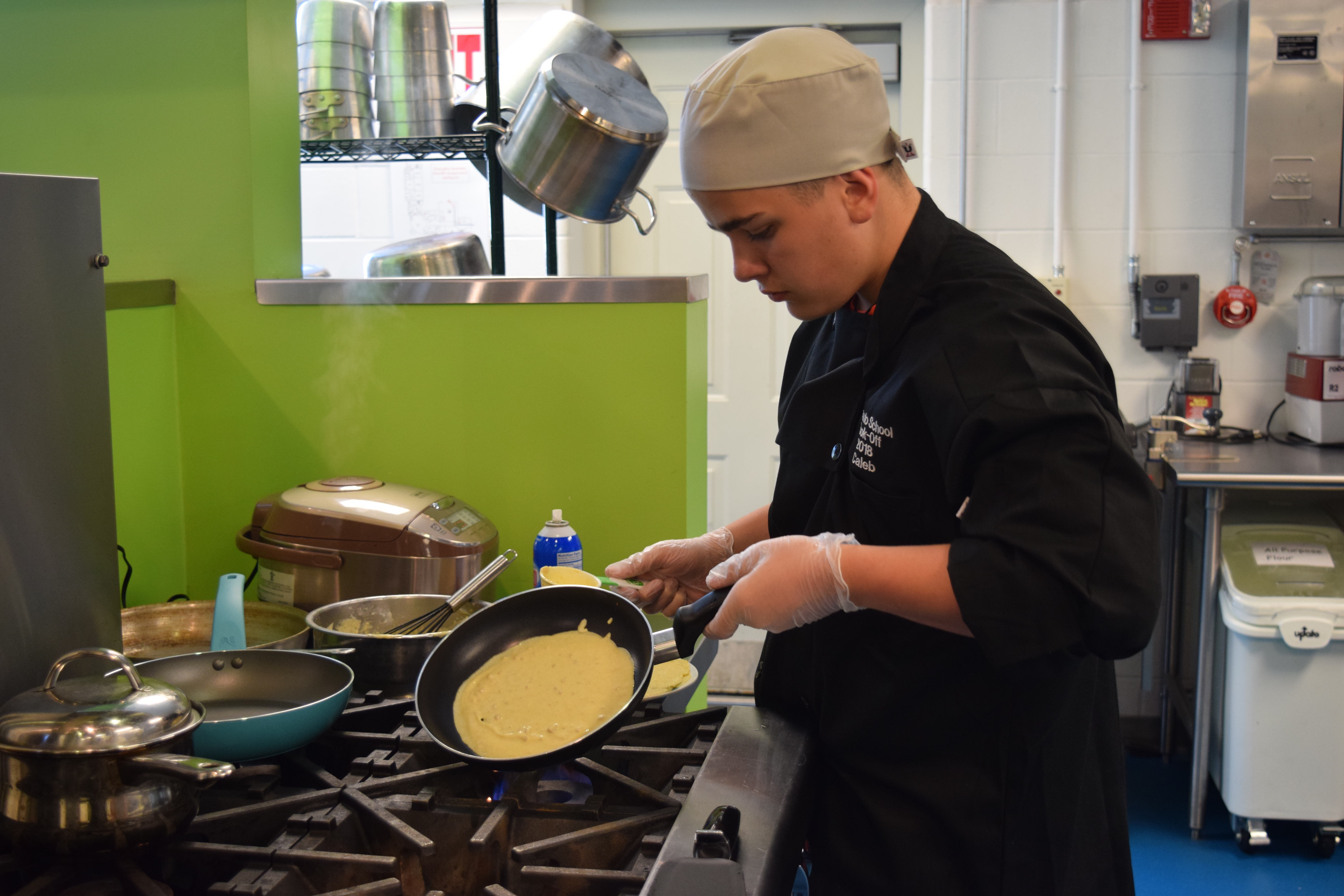 Caleb Pratt, 7th grade student from Skowhegan Area Middle School making the crepes for breakfast