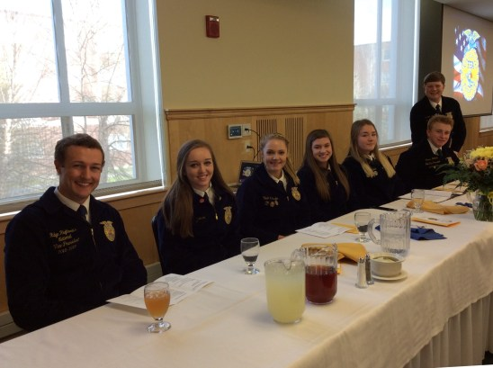 Awards Banquet Head Table: National FFA VP Ridge Hughbanks, Convention Sentinel Ava Cameron, Reporter Olivia Tardie, Treasurer Alli Kenney, Secretary Camryn Curtis, State Vice President James Hotham, State President Graham Berry.