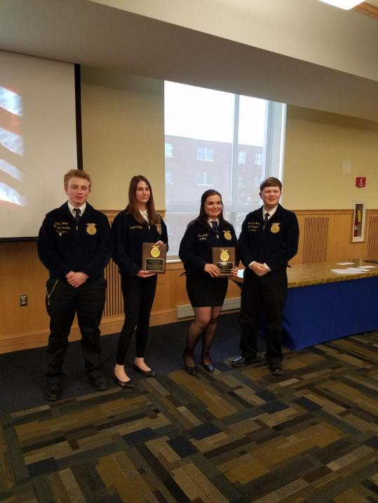 Outstanding FFA Chapter Officers of the Year: Alexis Pelkey (Easton) and Macy Coffin (Mars Hill), with State FFA President James Hotham (left) and State FFA President Graham Berry (right).