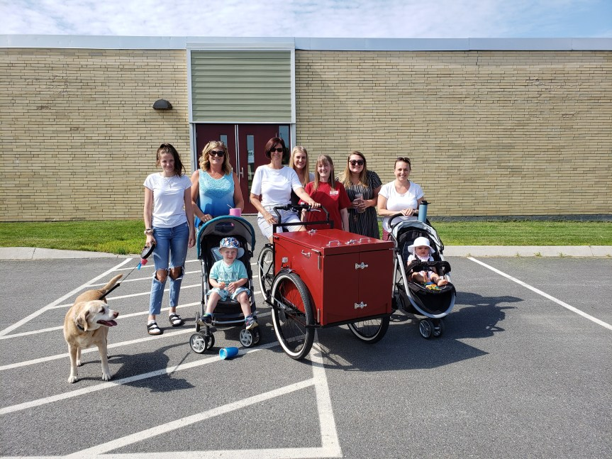 Downeast School Teachers and Staff Distribute Books to Children via Bicycle Library