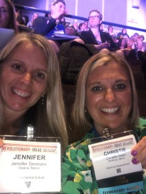 Two counselors pose together at conference with their name badges