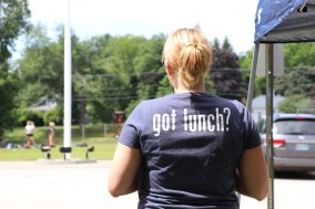 "Woman with a t-shirt that says ""Got Lunch?"""