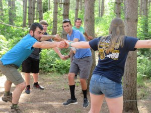 New England FFA Officers collaborate on low ropes activity (Maine FFA State President Graham Berry back left)