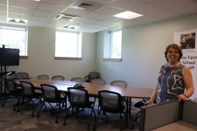 Maine DOE Child Nutrition staff member, Paula Nadeau stands in a new conference room at the DOE.