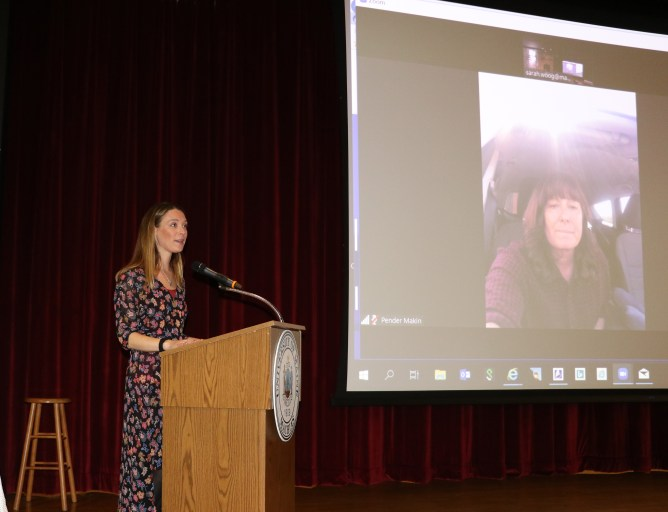 Sarah Woog introducing Commissioner Makin who participated via web conferencing to address educators.